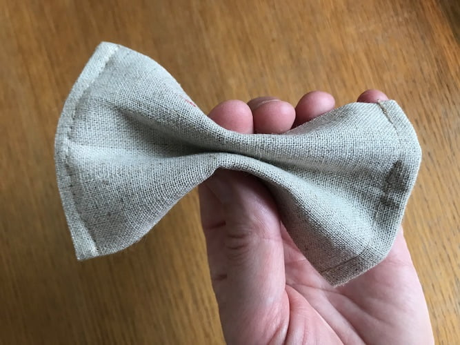 pinch the bow tie into shape