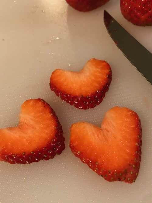 photo of sliced strawberries cut into heart shapes
