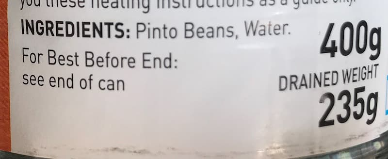 photo of the ingredients list on a can of pinto beans