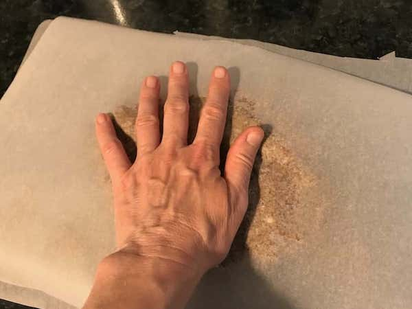 spread dog treat mix with hands